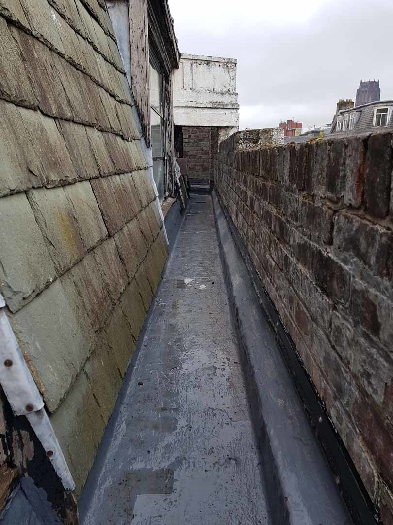 Sika Gutter Waterproofing and Lining Works, Liverpool. High Level Building Maintenance Services & Rope Access Contractors.