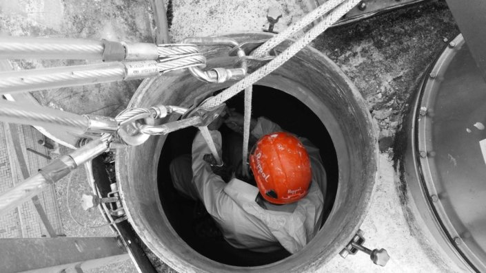 Rappel rope access and confined space trained team undertaking silo cleaning works