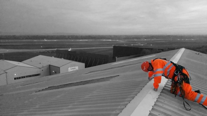 Rappel rope access system used to undertake commercial roof maintenance works