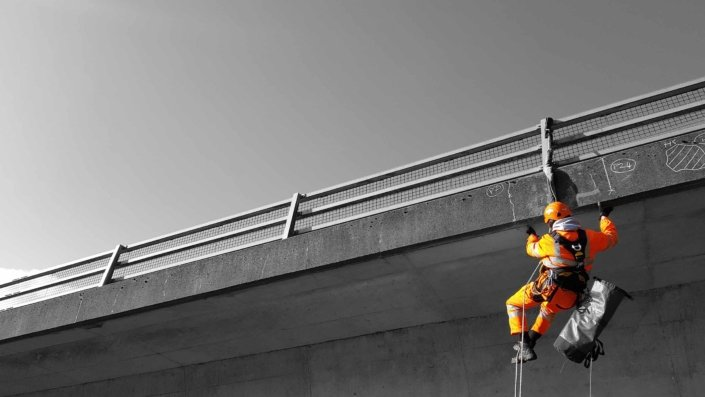 Rappel rope access technician undertaking a principal bridge inspection