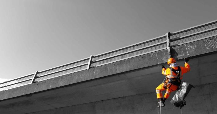 Rappel rope access technician undertaking a principal bridge inspection