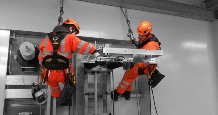 Rappel rope access technicians undertaking high level industrial cleaning works